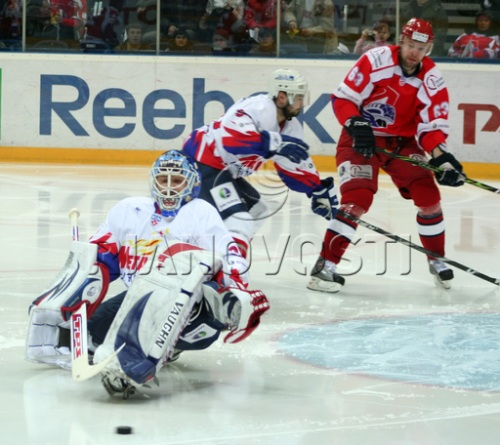 When Canadian hockey players won't stand up for their country, why not bring in Europeans to teach them all a lesson or two. (Action from a KHL game)